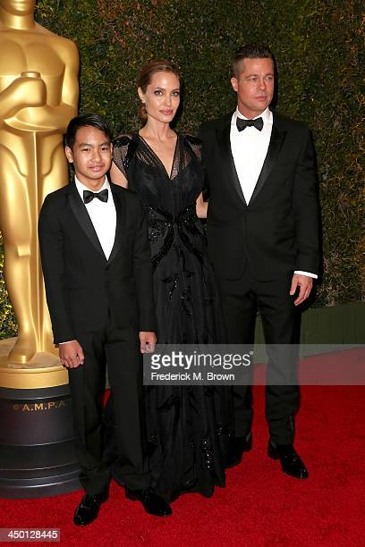 Maddox Jolie-Pitt, actress Angelina Jolie and actor Brad Pitt arrive at the Academy of Motion Picture Arts and Sciences' Governors Awards at The Ray...