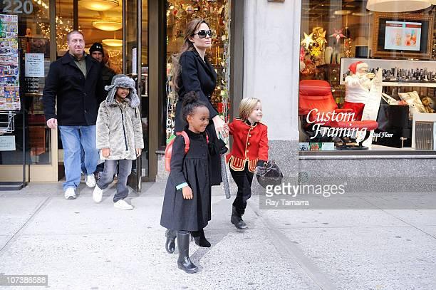 Maddox JoliePitt actress Angelina Jolie Zahara JoliePitt and Shiloh JoliePitt leave Lee's Art Shop on December 7 2010 in New York City