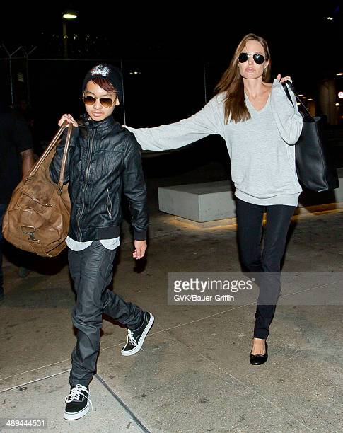 Maddox JoliePitt and Angelina Jolie are seen at LAX airport on February 14 2014 in Los Angeles California