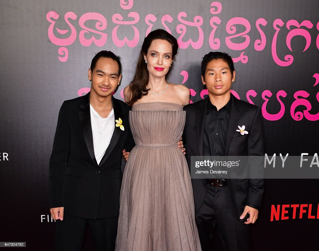 Maddox Jolie-Pitt, Angelina Jolie and Pax Jolie-Pitt arrive to the DGA Theater for the New York premiere of 'First They Killed My Father' on September 14, 2017 in New York City.
