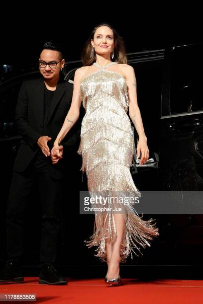 Maddox Jolie-Pitt escorts Angelina Jolie upon arriving at the Japan premiere of 'Maleficent: Mistress of Evil' on October 03, 2019 in Tokyo, Japan.