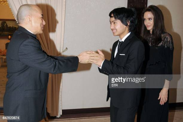 Maddox JoliePitt greets Cambodian King Norodom Sihamoni as Hollywood star Angelina Jolie looks on during an audience at the royal residence in Siem...