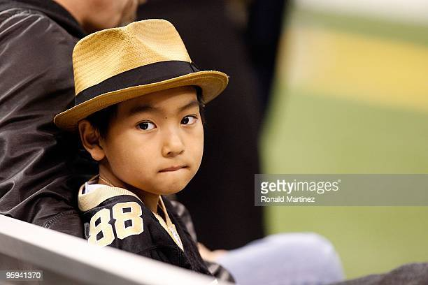 Maddox JoliePitt sits on the bench on the sidelines during warm ups prior to the New Orleans Saints hosting the Arizona Cardinals during the NFC...