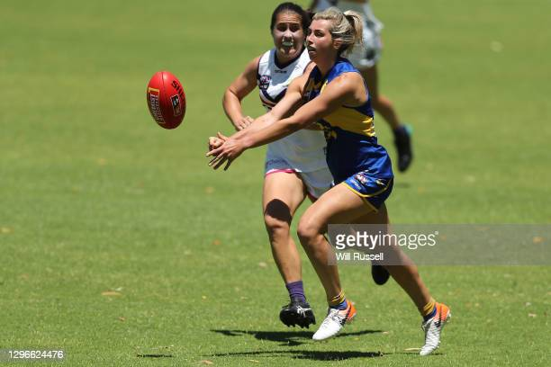 Maddy Collier of the Eagles handballs under pressure from Gabby O'Sullivan of the Dockers during an AFLW pre-season match between the West Coast...