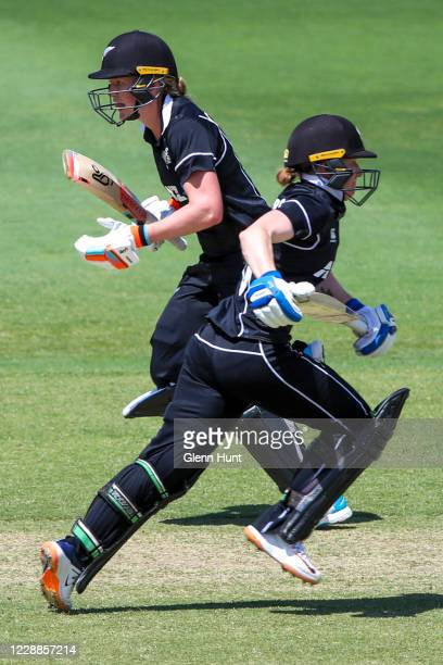 Maddy Green and Katie Perkins of New Zealand run between the wickets during game one in the women's One Day International Series between Australia...