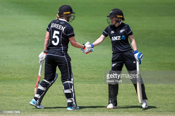 Maddy Green and Katie Perkins of New Zealand shake hands during game one in the women's One Day International Series between Australia and New...