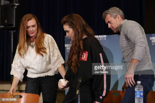 Maddy Wilford prepares to leave with her parents Missy Wilford and David Wilford after speaking to the media at Broward Health North where she was...