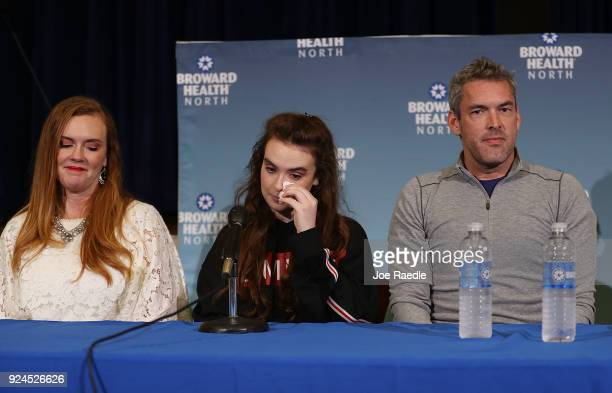 Maddy Wilford sits with her parents Missy Wilford and David Wilford as she speaks to the media at Broward Health North after being shot multiple...