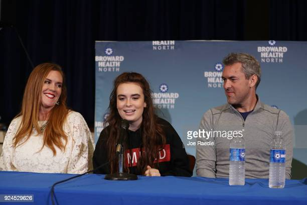 Maddy Wilford sits with her parents Missy Wilford and David Wilford as she speaks to the media at Broward Health North where she was treated after...