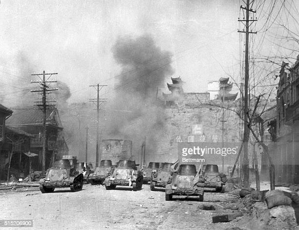 Made a day after they had captured the former Chinese capital city on December 13 this picture shows victorious Japanese infantrymen patrolling the...