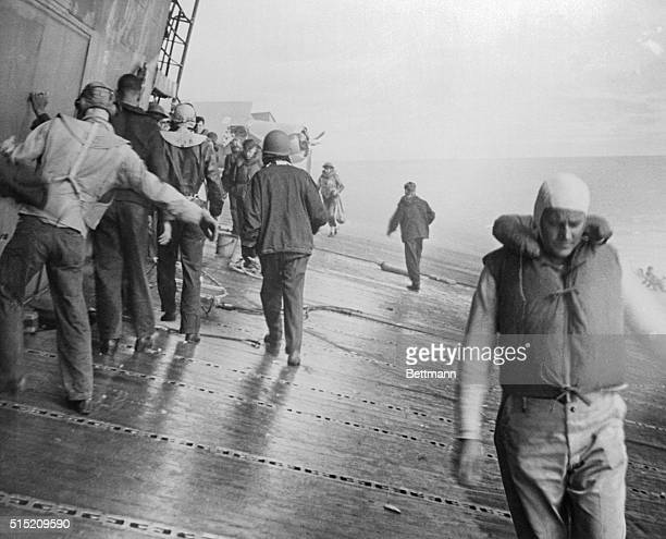 Made by a Navy photographer aboard the stricken ship this photo shows the deck of the USS Yorktown aircraft carrier listing badly after she had been...