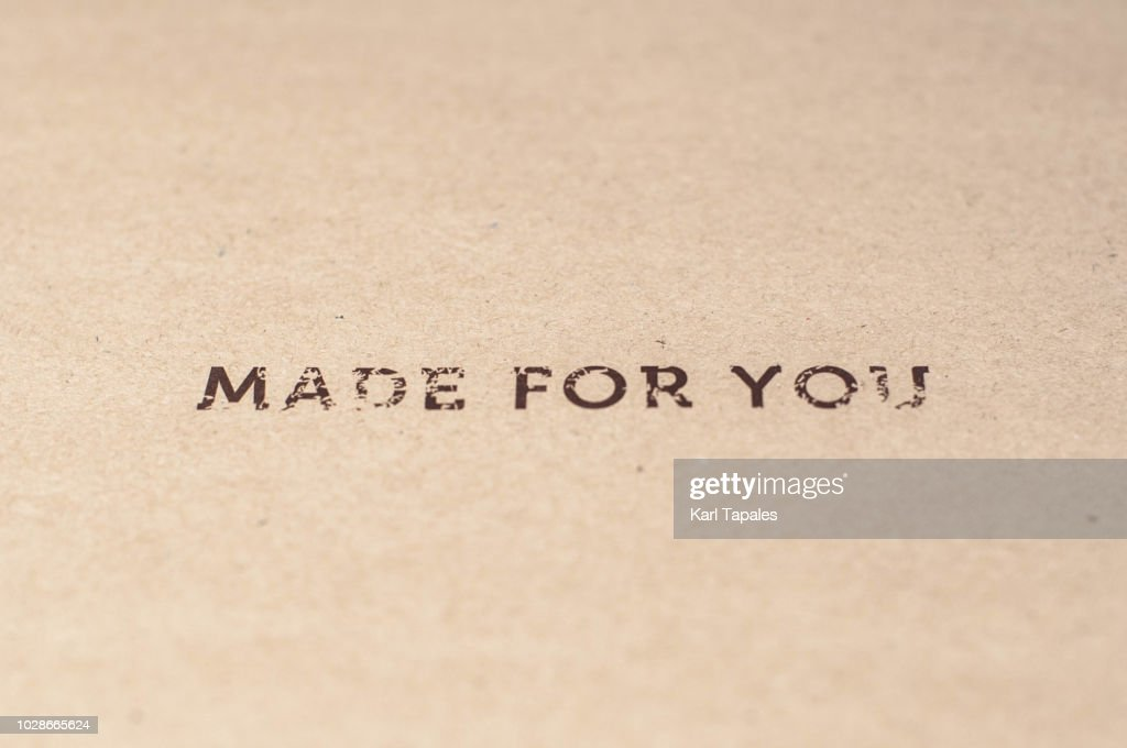 """A """"made for you"""" sign written on a brown paper : Stock Photo"""