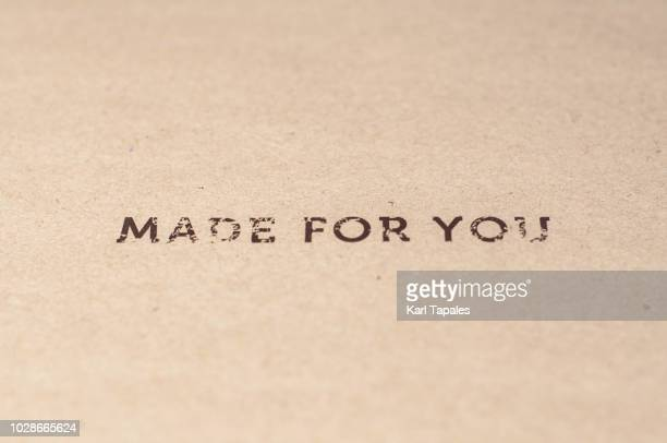 "A ""made for you"" sign written on a brown paper"