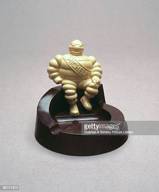 Made from walnut coloured Bakelite it has a 'Michelin' man of ivory urea formaldehyde sitting on its edge and was made to promote Michelin tyres...