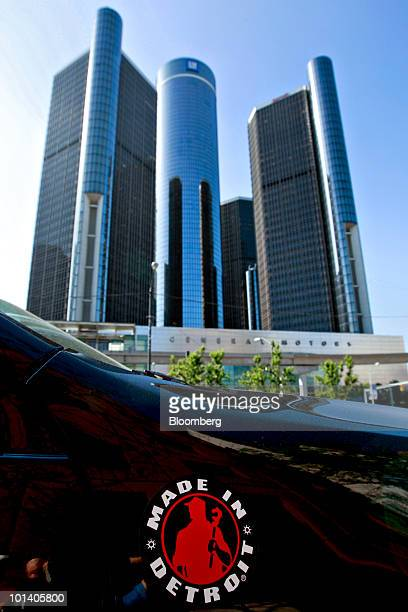 """Made in Detroit"""" sticker is seen on a car outside the headquarters building of General Motors Co. In Detroit, Michigan, U.S., on Tuesday, June 1,..."""