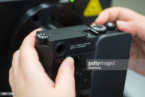 A 'Made In Germany' sign sits on the back of a Leica M10 rangefinder digital camera as an employee carries out sensor checks at the Leica Camera AG...