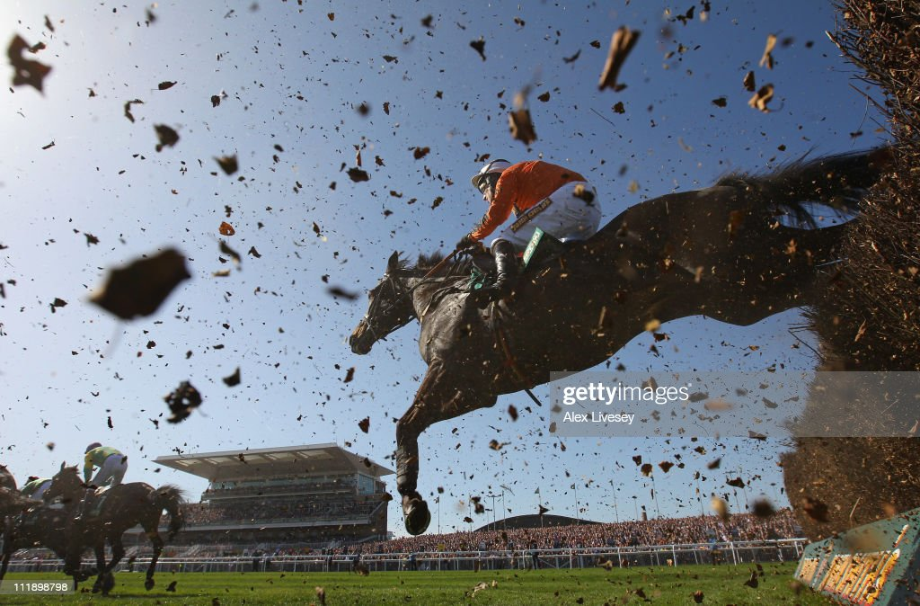 Made In Taipan ridden by Robbie Power clears the last fence during The John Smith's Melling Steeple Chase during Ladies' Day at Aintree Racecourse on April 8, 2011 in Liverpool, England.
