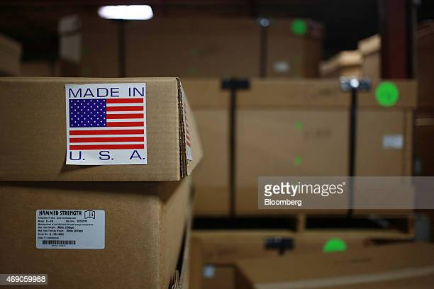 A 'Made In The USA' sticker is seen on a box containing Hammer Strength weightlifting equipment at the Life Fitness manufacturing facility in...