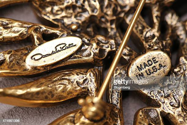 A 'Made in USA' stamp sits on an item of jewelry by Oscar de la Renta for sale at the boutique store for luxury fashion retailer Aizelru in Moscow...