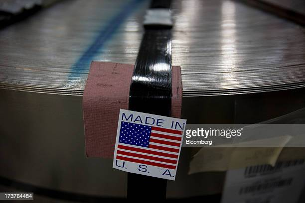 A 'Made in USA' sticker is placed on a coil of metal which will be used to stamp nickels at the US Mint in Philadelphia Pennsylvania US on Wednesday...