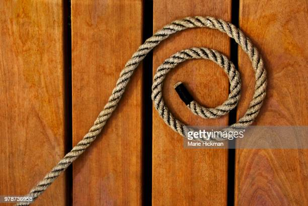 SPIRAL SHAPE made of ROPE on a wooden boat dock at Lake George, NY.