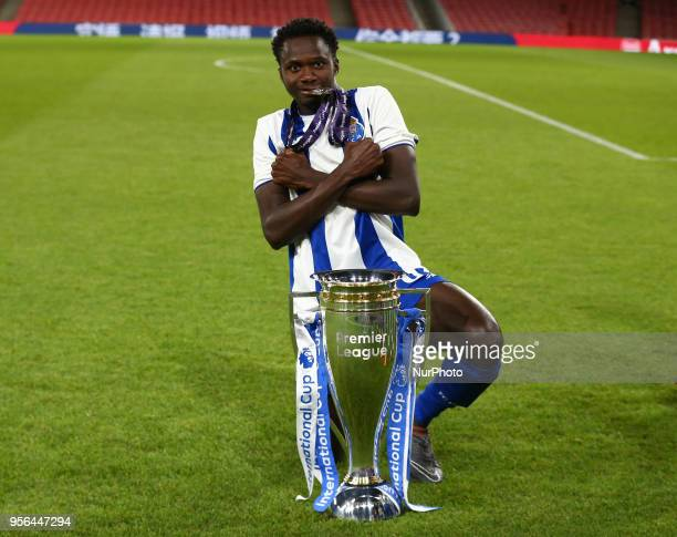 Made Queta of Porto FC celebrates with Trophy after scoring the winning goal After Premier League International Cup Final match between Arsenal Under...