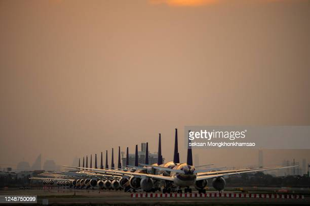 covid-19 made the airline must announce to temporarily stop all routes - suvarnabhumi airport stock pictures, royalty-free photos & images
