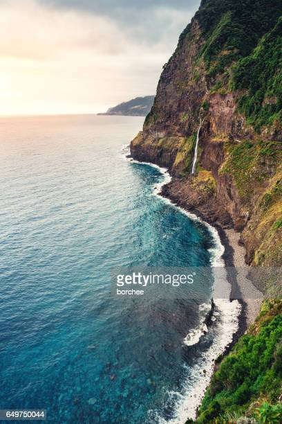 madeira coastline with waterfall - madeira island stock photos and pictures