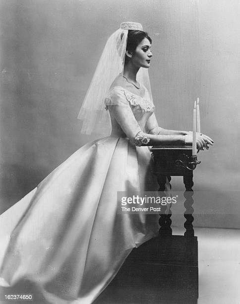 MAR 4 1982 Madeira linen cutwork provides surprise touch as bib and cuffs for rayon and silk taffeta gown By Belle Bride Styles it has simple serene...