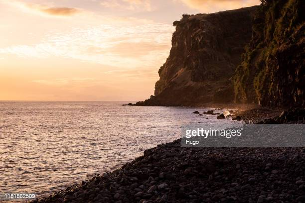 madeira seascape at sunset - rocky coastline stock pictures, royalty-free photos & images