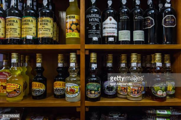 madeira wine bottles on the shelf, portugal - madeira stock photos and pictures