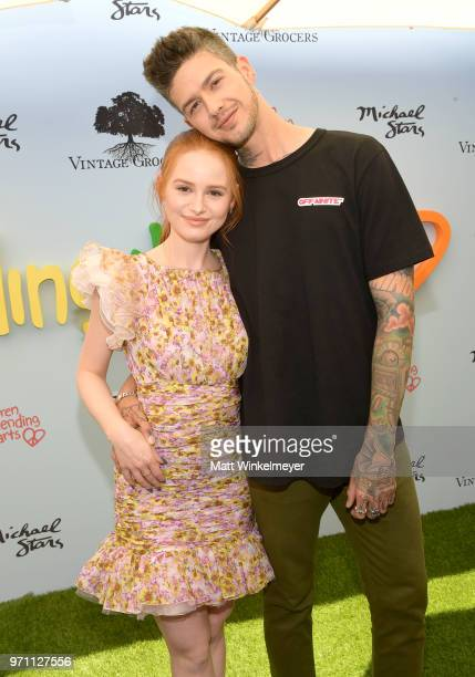 Madelaine Petsch and Travis Mills attend Children Mending Hearts' 10th Annual Empathy Rocks on June 10 2018 in Los Angeles California