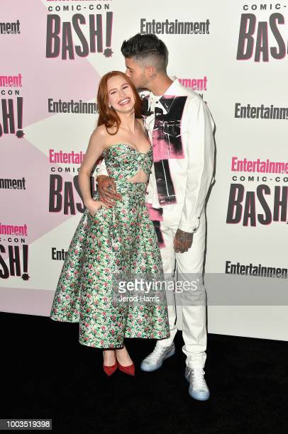 Madelaine Petsch and Travis Mills attend Entertainment Weekly's ComicCon Bash held at FLOAT Hard Rock Hotel San Diego on July 21 2018 in San Diego...