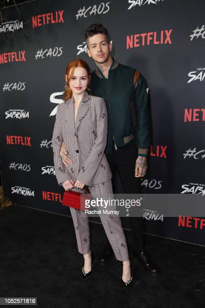 Madelaine Petsch and Travis Mills attend Netflix Original Series Chilling Adventures of Sabrina red carpet and premiere event on October 19 2018 in...