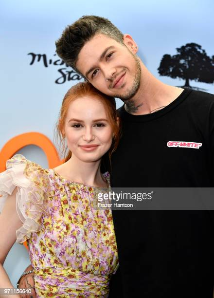 Madelaine Petsch and Travis Mills attend the 10th Annual Empathy Rocks Fundraiser at Private Residence on June 10, 2018 in Bel Air, California.