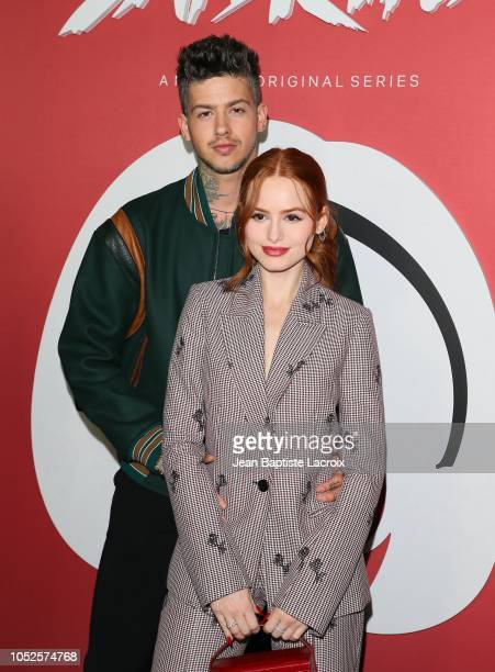 Madelaine Petsch and Travis Mills attend the premiere of Netflix's 'Chilling Adventures of Sabrina' at Hollywood Athletic Club on October 19 2018 in...