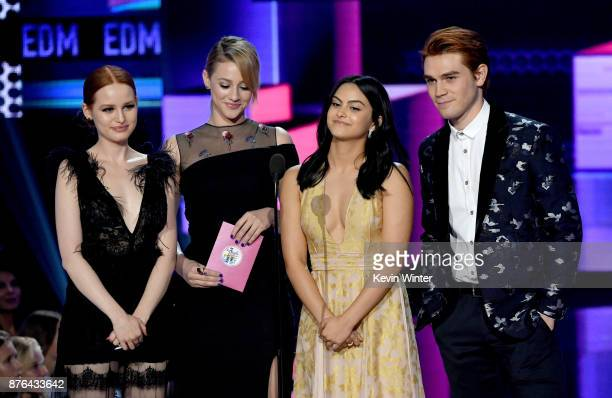 Madelaine Petsch Lili Reinhart Camila Mendes and KJ Apa speak onstage during the 2017 American Music Awards at Microsoft Theater on November 19 2017...