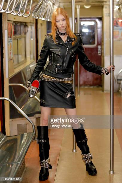 Madelaine Petsch walks the runway during Moschino Prefall 2020 Runway Show at New York Transit Museum on December 09, 2019 in Brooklyn City.