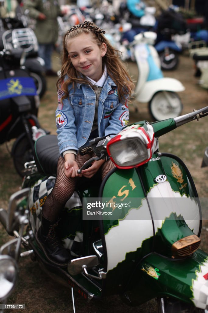 Madelaine Watson, 9, from Derbyshire sits on Scooters ahead of the 'Ride Out' on August 25, 2013 in Ryde, England. The annual event, which is organized by the British Scooter Rally Association and The VFM Scooter Collective, attracts around 6000 riders each year and has been running since 1980. The scooter in 1960s Britain was a fashion statement and the often heavily customized bikes, usually an Italian Vespa or Lambretta, became synonymous with the Mod scene. They provided an inexpensive mode of transport and escapism to an upwardly mobile youth at a time when public transportation stopped early. The Vespa was depicted on the cover of The Whos Quadrophenia album in 1973.