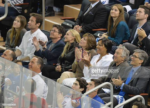 Madelaine West Duchovny actor David Duchovny actress Tracy Pollan actor Michael J Fox Grace Hightower and actor Robert De Niro attend game four of...