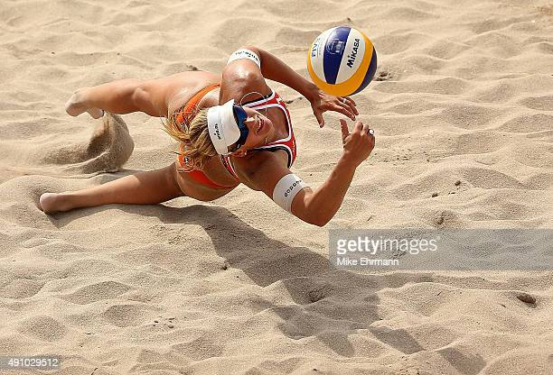 Madelein Meppelink of the Netherlands plays a shot during a match against Agatha Bednarczuk and Barbara Seixas of Brazil at the FIVB Fort Lauderdale...