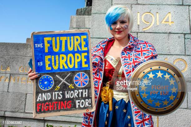 Madeleina Kay Alba White Wolf Young European of the Year 2018 is seen holding a placard and a shield with the EU flag during the protest A day before...