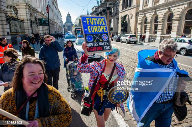 Madeleina Kay Alba White Wolf Young European of the Year 2018 is seen holding a placard during the protest A day before the anniversary of the...