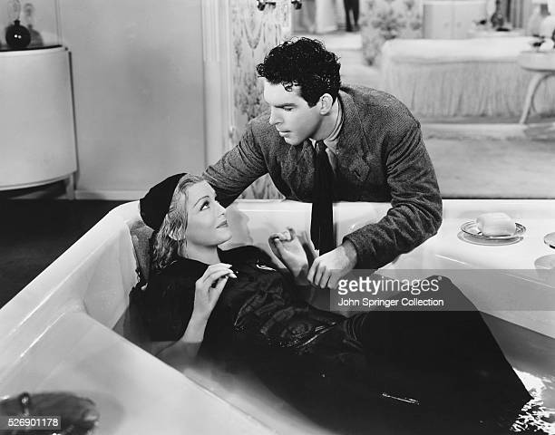 Madeleine Carroll as Christopher West and Fred MacMurray as Chick O'Bannon in the 1939 film Cafe Society.