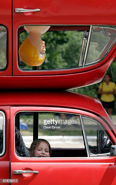"""Madeleine Clay sits in her father's car """"Mirror Image"""" during the Everyones Art Car Parade May 14, 2005 in Houston, Texas. The parade includes around..."""