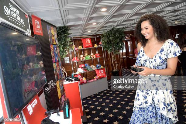 Madeleine Mantock tests her skills on Super Smash Bros Ultimate for Nintendo Switch at the Variety Studio at ComicCon 2018 on July 20 2018 in San...