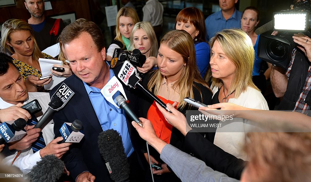 Madeleine Pulver (C), her father Bill (L) and mother Belinda (R) speak to the media outside of the court in Sydney on November 20, 2012. An investment banker who attached a fake bomb around the neck of Pulver, a Sydney schoolgirl, in a bid to extort money from her wealthy family was jailed for at least 10 years. Paul Peters, who was arrested and extradited from the United States in September last year with the help of the FBI, pleaded guilty earlier this year to aggravated breaking and entering and detaining the teenager for advantage. AFP PHOTO/William WEST