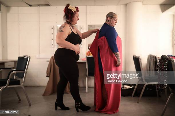 Madeleine Soleil helps Smashlyn Monroe with her costume in the dressing room before performing at the World Burlesque Games 2017 on November 4 2017...