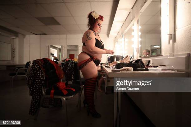 Madeleine Soleil of the United Kingdom prepares her costume in the dressing room before performing at the World Burlesque Games 2017 on November 4...