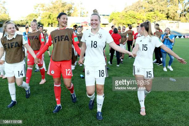 Madeleine Steck, Maria Luisa Grohs, Charlotte Bluemel and Lina Jubel of Germany celebrate after the FIFA U-17 Women's World Cup Uruguay 2018 group C...